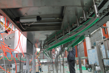 Fan blowing conveyor system for empty bottles